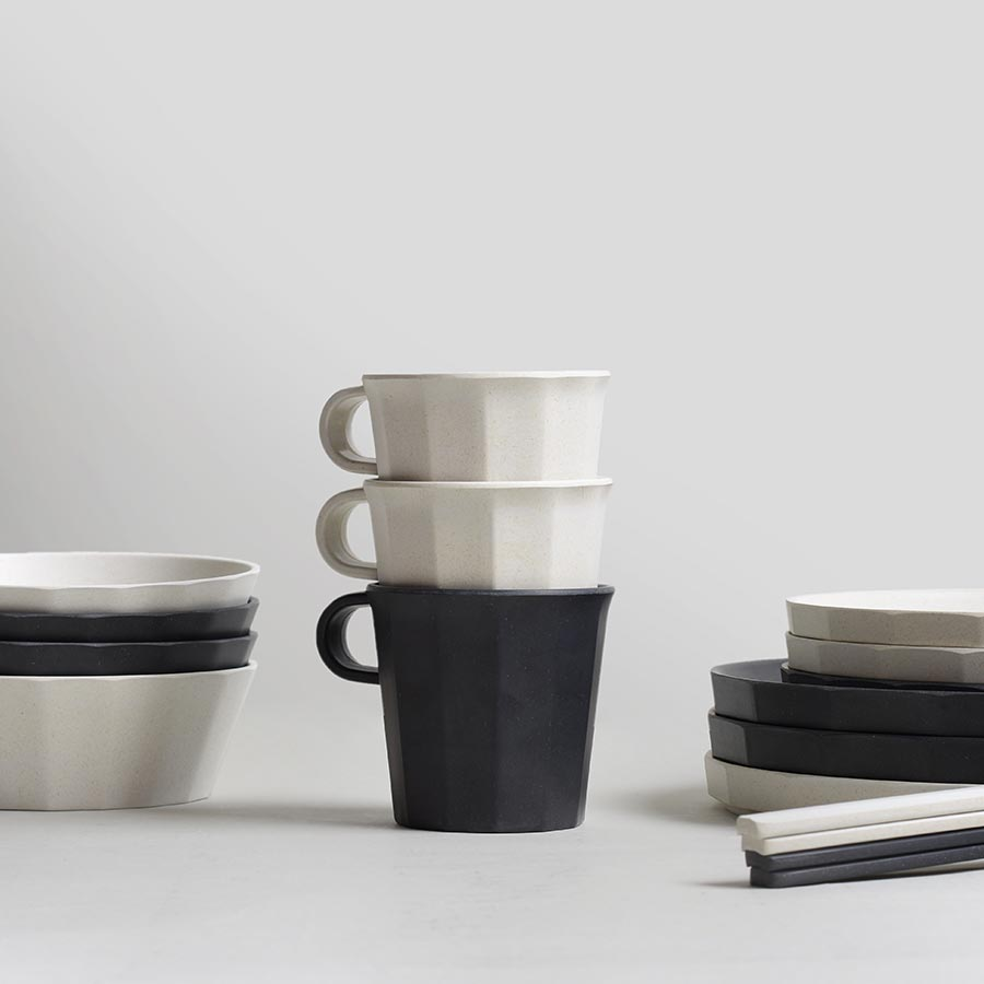 ALFRESCO bowls, plates, and mugs in black and white stacked