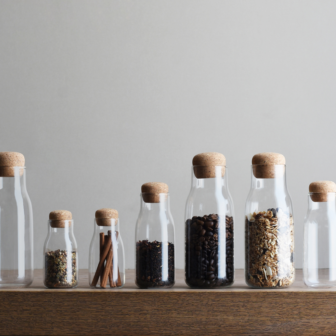 BOTTLIT canister collection filled with assortment of goods such as coffee beans, oatmeal, and cinnamon sticks