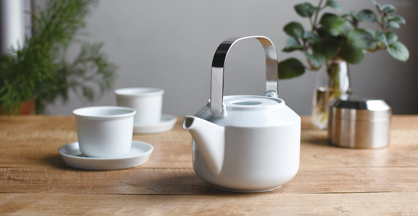 LT teapot in white with cup and saucer on a table
