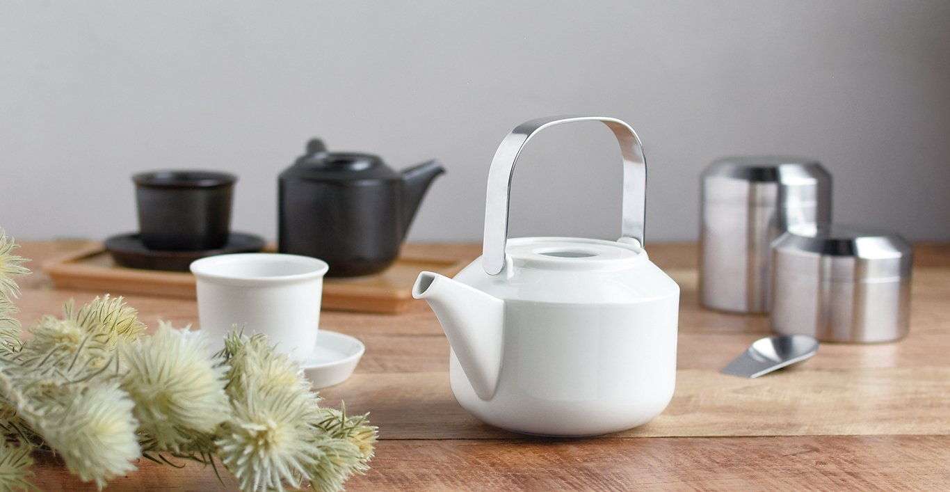 LT teapot in white and cup and saucer. LT kyusu teapot in black with cup and saucer on LT tray. LT tea canister with LT tea scoop