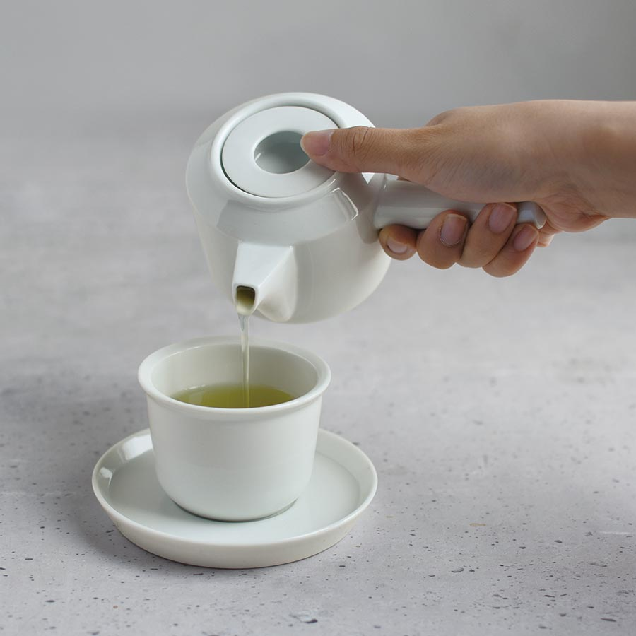 Pouring tea into LT cup and saucer with LT kyusu teapot