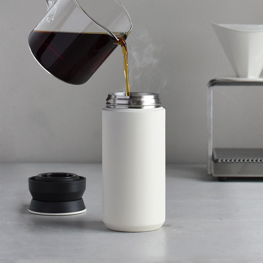 Coffee being poured into the TRAVEL tumbler 500ml in white