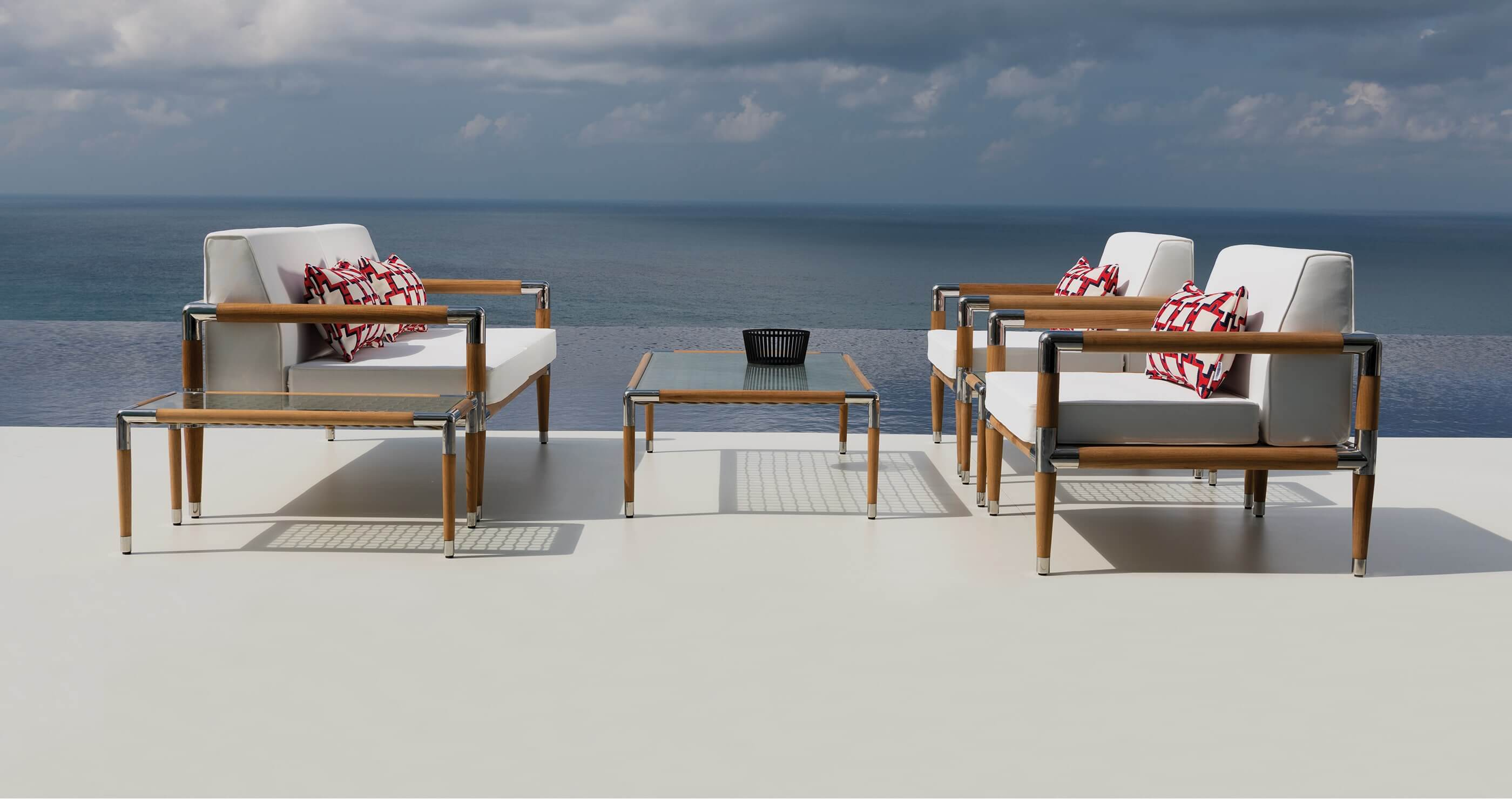 Indian Ocean furniture: luxury outdoor coffee table and chairs with the ocean in the background