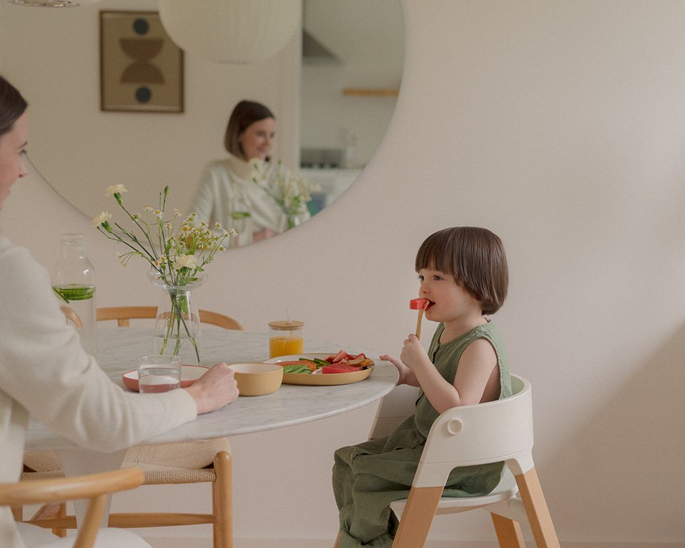 Toddler eating fruits with BONBO folk in yellow