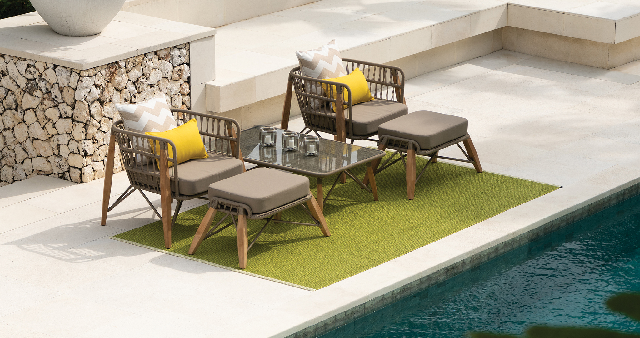 Luxury outdoor Pimlico sofas and footstools by the pool