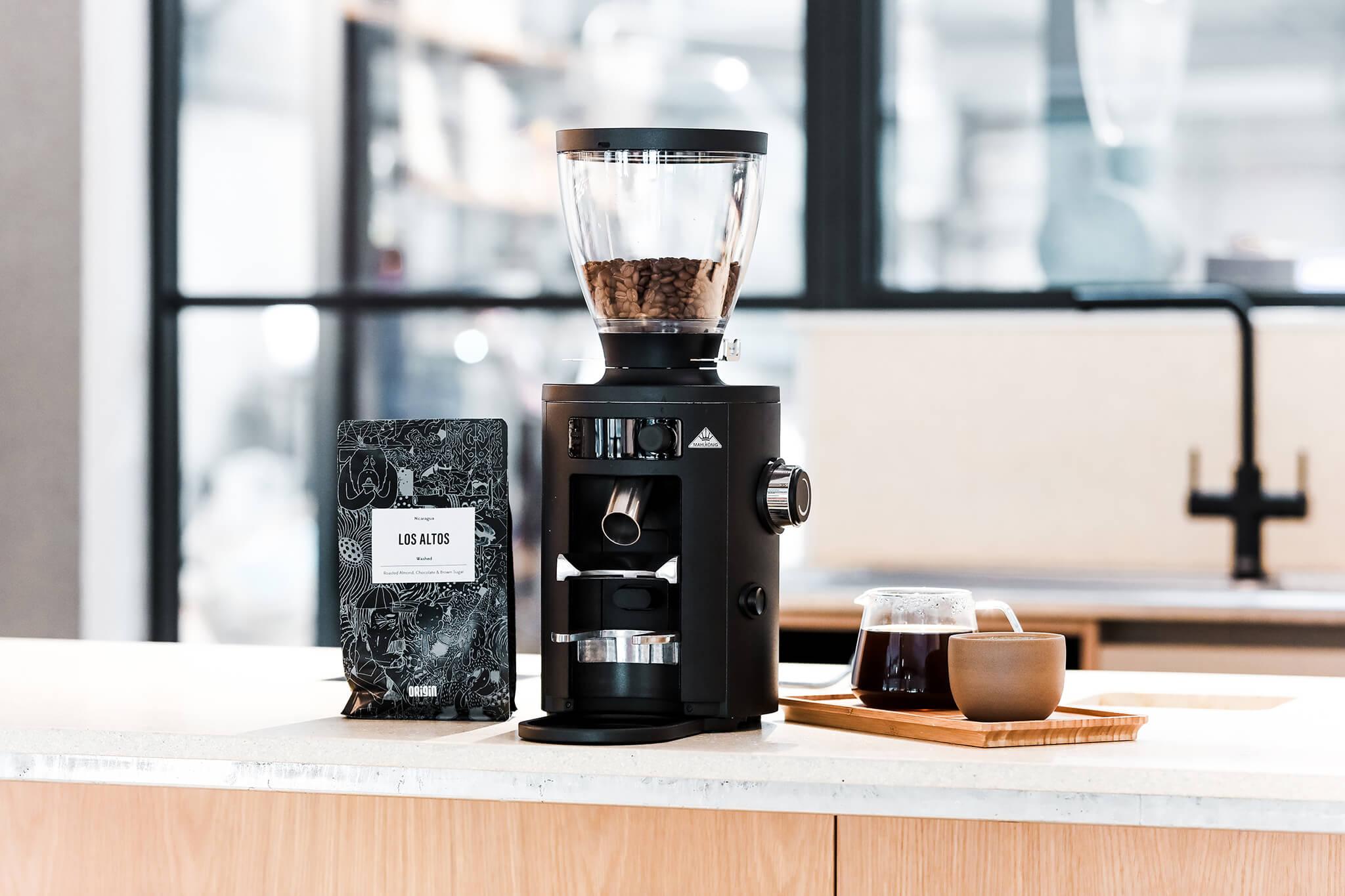 A home coffee grinder sitting on a bar