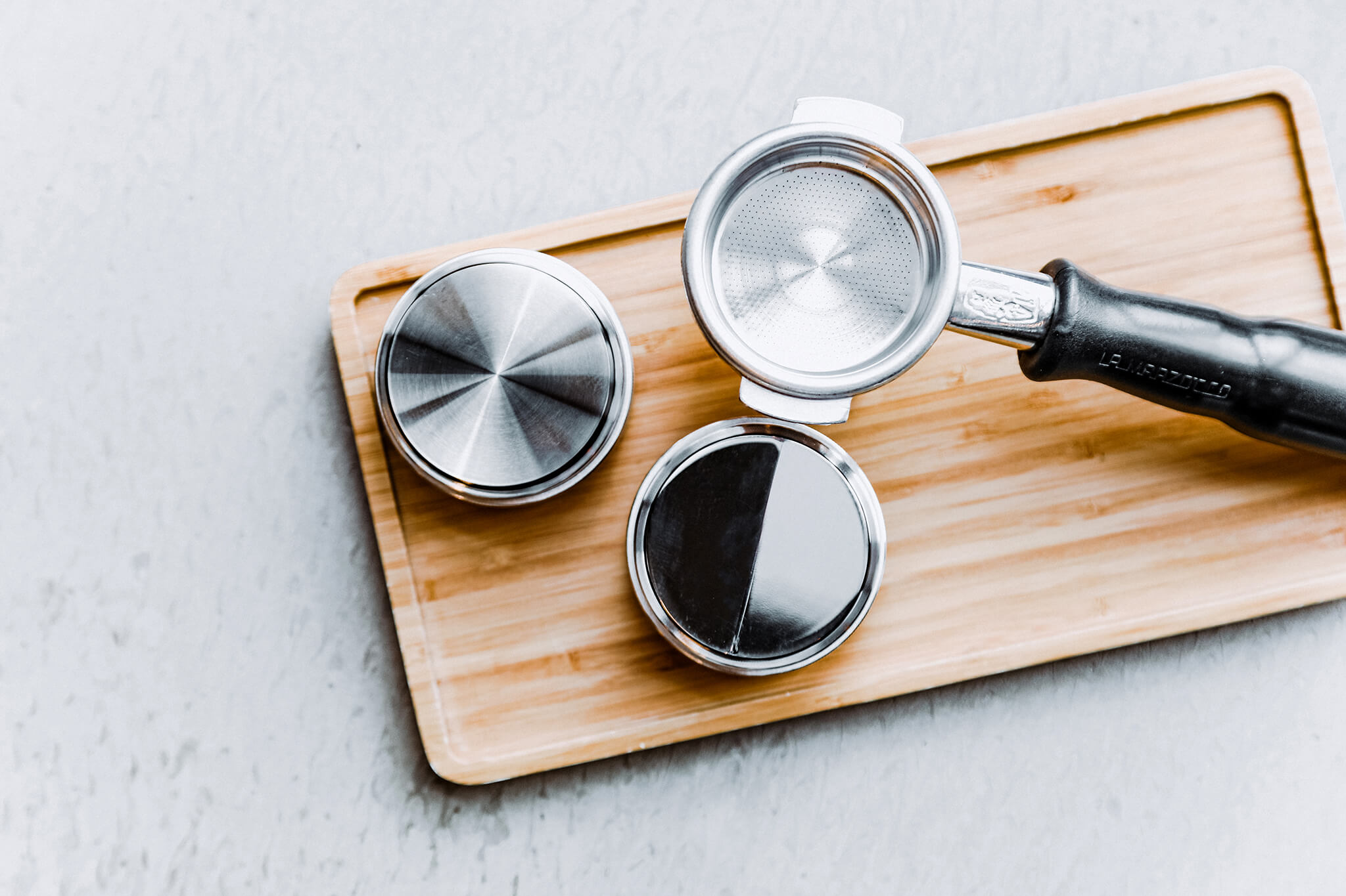 A set of coffee tampers sitting on the table