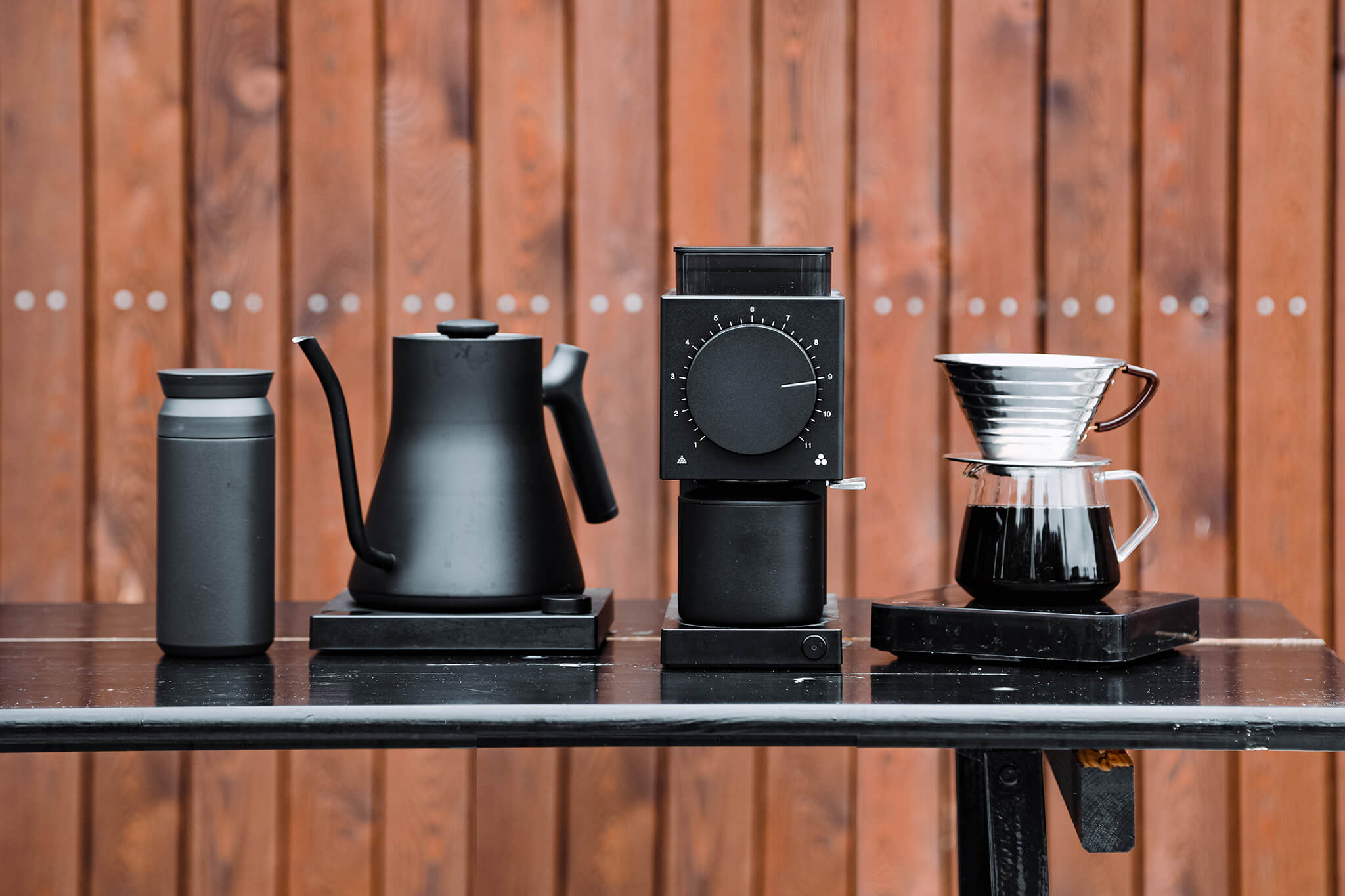 A selection of home coffee brewing equipment on a table