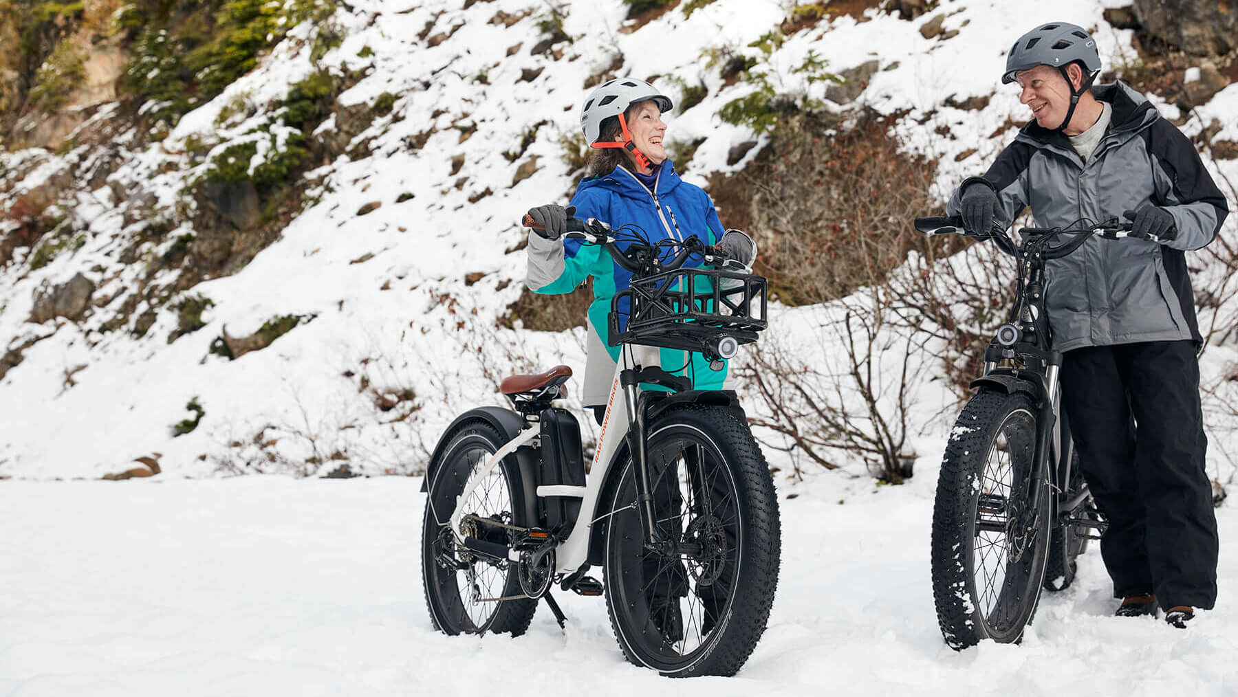 man and woman with ebikes