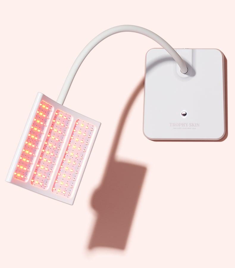 Trophy Skin's RejuvaliteMD LED treatment on Pink Background