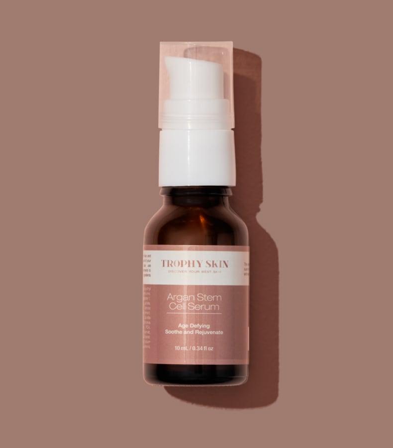 Trophy Skin's Anti-Aging Serum on Brown Background