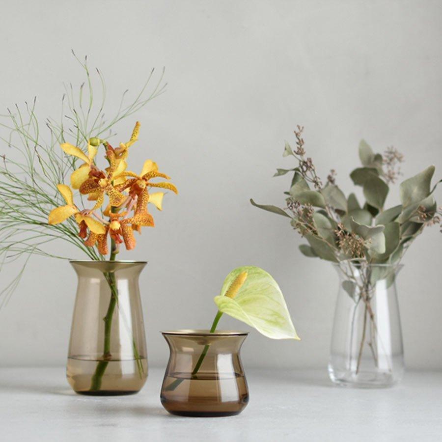 Three LUNA vases with assortment of flowers on a counter top