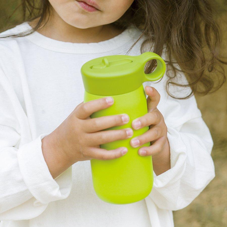 Little girl holding lime green PLAY tumbler