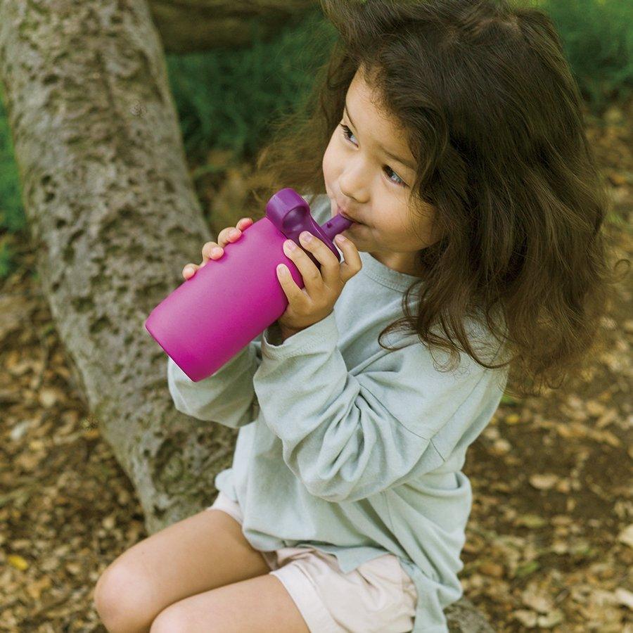 Little girl drinking out of the purple PLAY tumbler