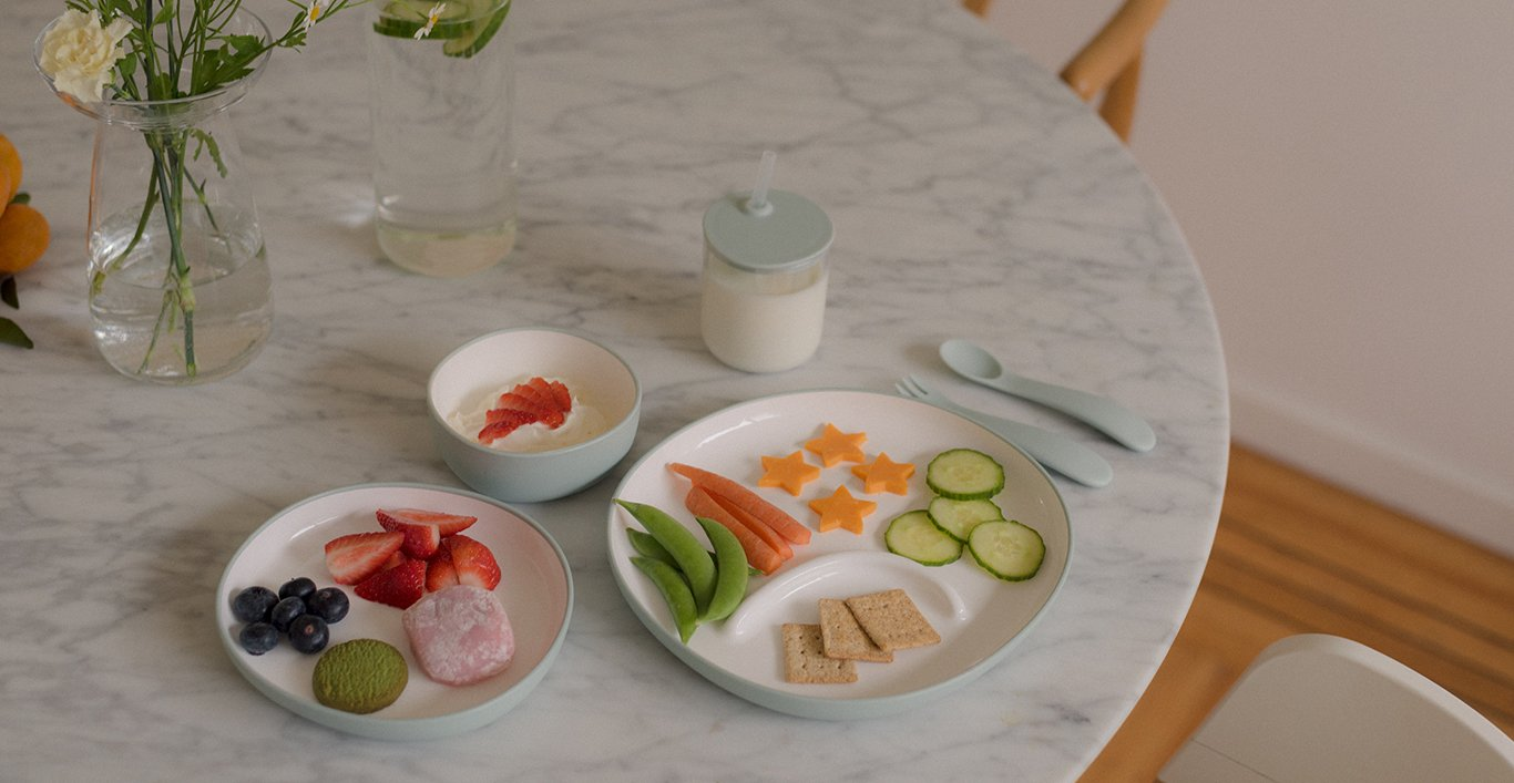 BONBO collection of plates, bowl, fork, spoon, and straw cup in blue gray with snacks