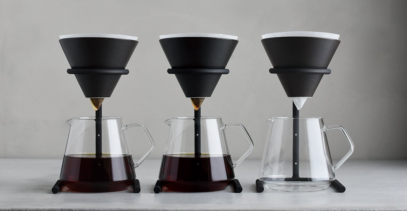 Three SCS-S04 brewer stands with two filled with coffee and one empty