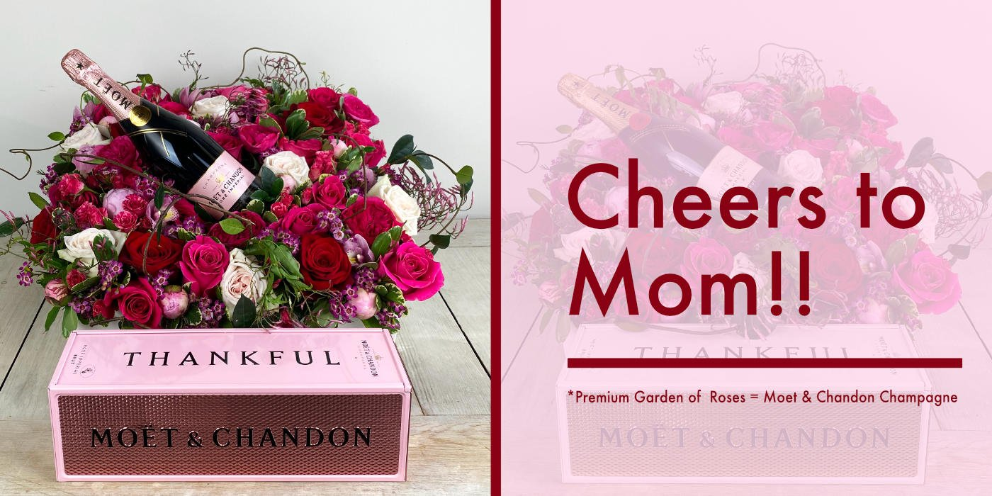 Premium Garden of Roses. White and Pink O'Hara are accompanied by Tess, Darcy, and Pink Myra Garden Roses, Beautiful Cymbidium Orchids, Peonies, and Wax Flowers. In a long garden box laced with Jasmine Vine and Moss.  and a bottle of champagne