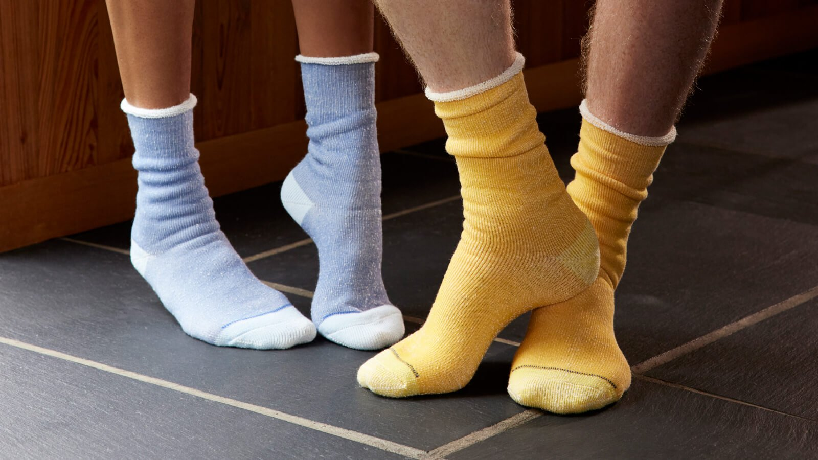 2 models showing off Brooklinen's latest sock collection.