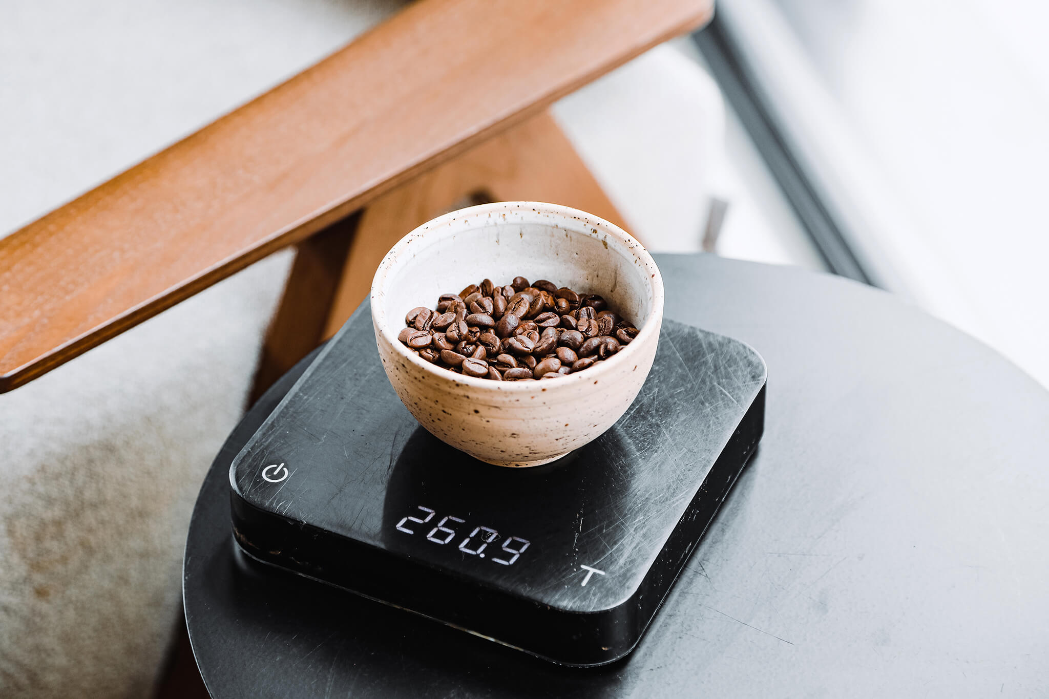 A set of coffee scales being used