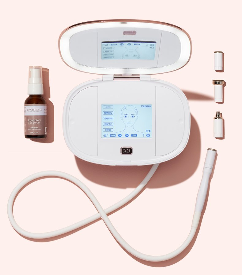 Revolutionary Microderm and More: UltradermMD Kit and Anti-Aging Serum on Pink Background