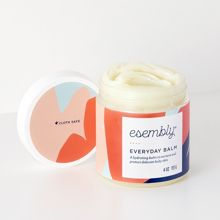 An open jar of Esembly Everyday Balm