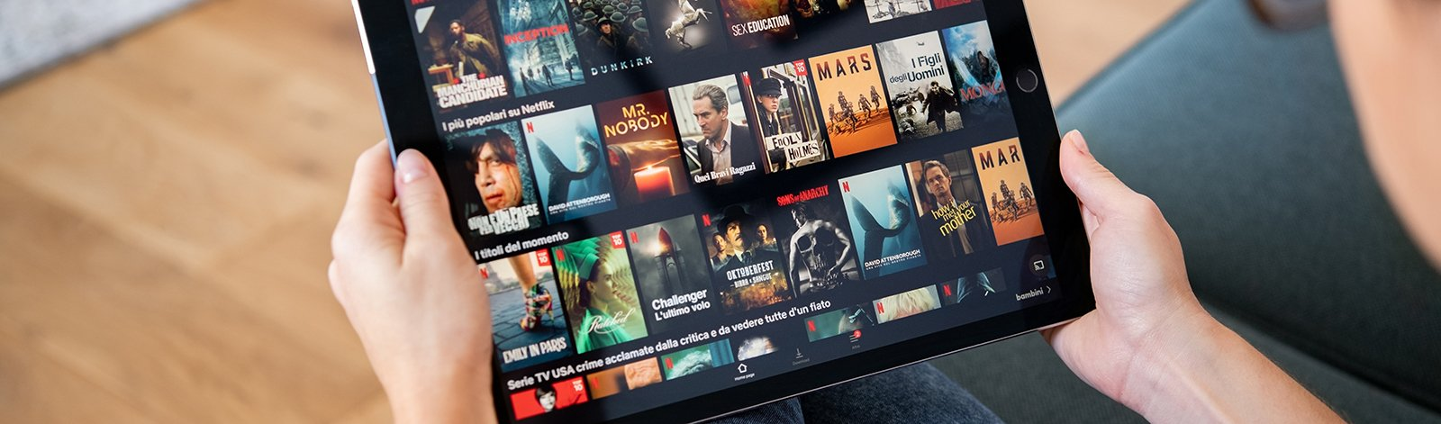 Woman watching Netflix on digital tablet