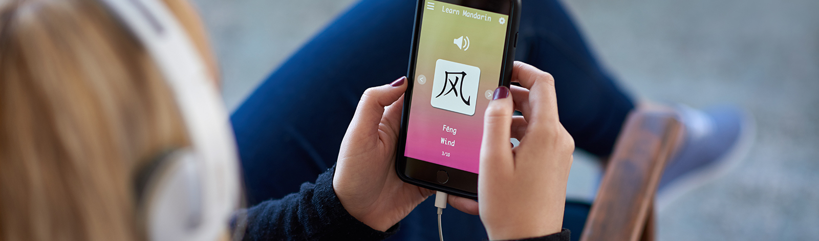 Woman using learning language app on smartphone