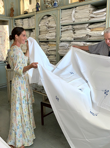 Rebecca de Ravenel in a shop with some beautiful Portuguese linen
