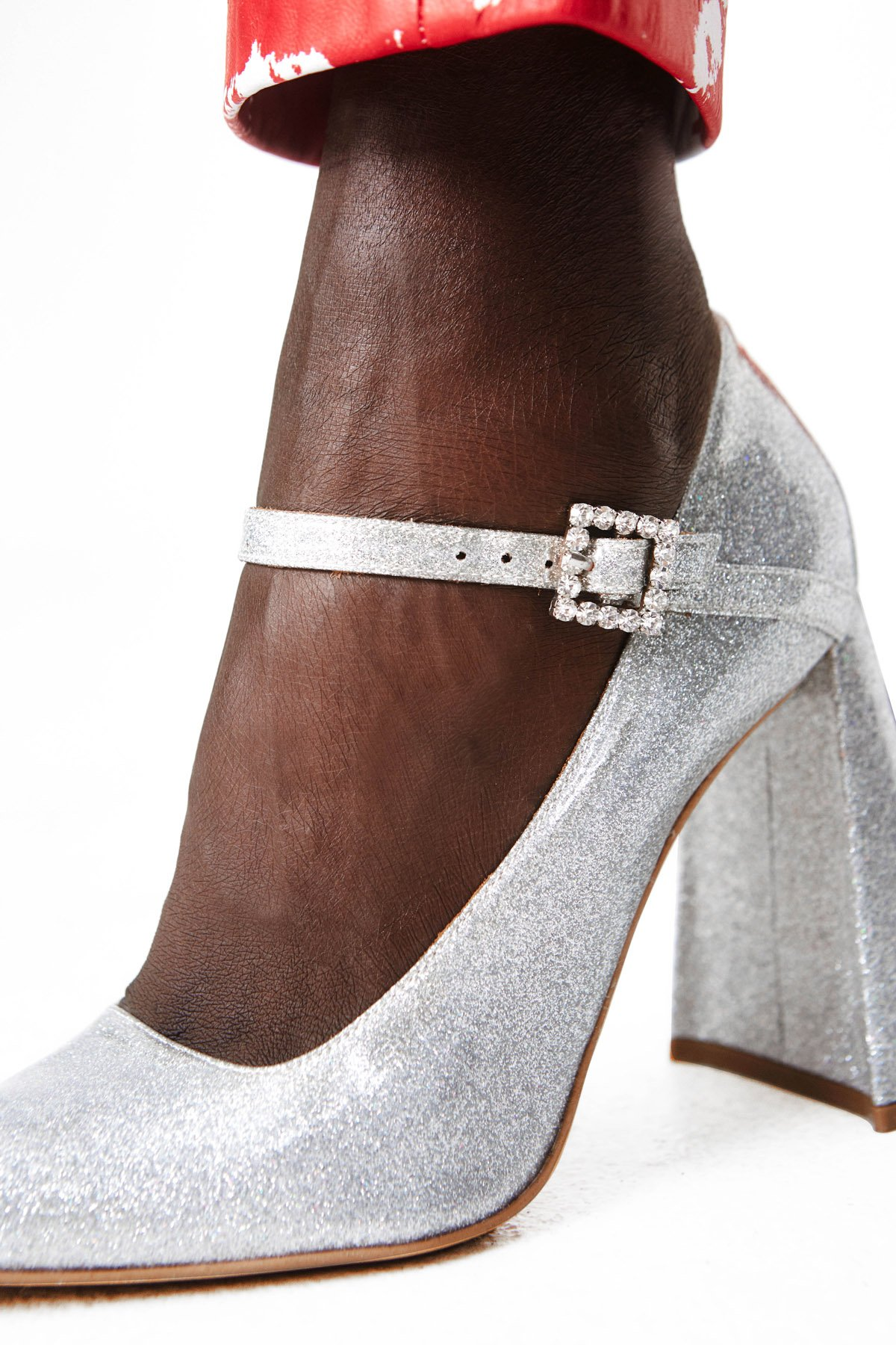 These pointed toe leather pumps feature a 90mm block heel and a Mary Jane-style strap with a shimmering crystal square buckle.