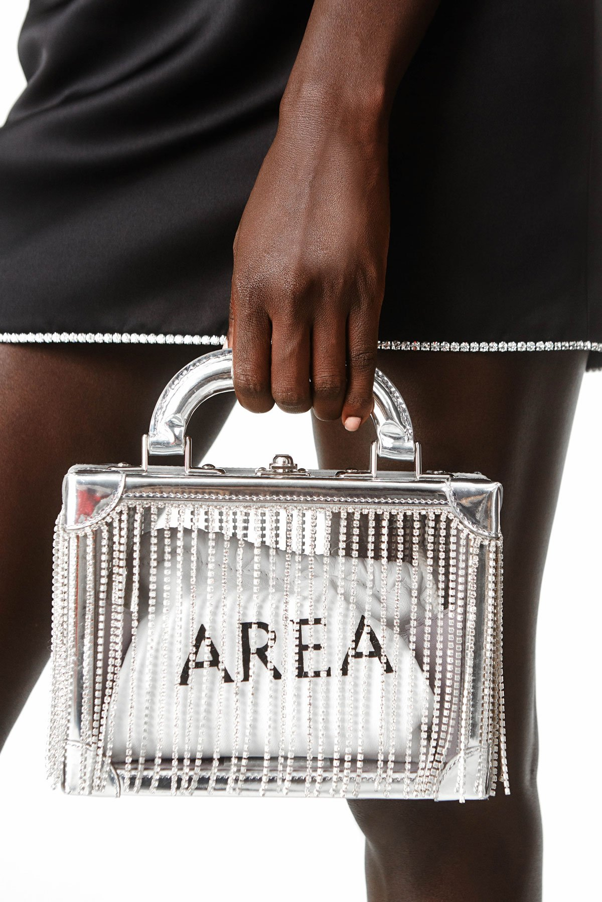 STRUCTURED IN A SHIMMERING SQUARE SILHOUETTE WITH A PALLADIUM BRASS CLOSURE. CRYSTAL-CUT FRINGED DETAILING THROUGHOUT. CRAFTED IN SILVER PATENT CALF LEATHER AND CLEAR PVC. INCLUDES A REMOVABLE CHAIN-LINK STRAP AND A WHITE LOGO-EMBOSSED POCHETTE.  MADE IN COLLABORATION WITH ITALIAN LEATHER HERITAGE HOUSE BERTONI 1949.