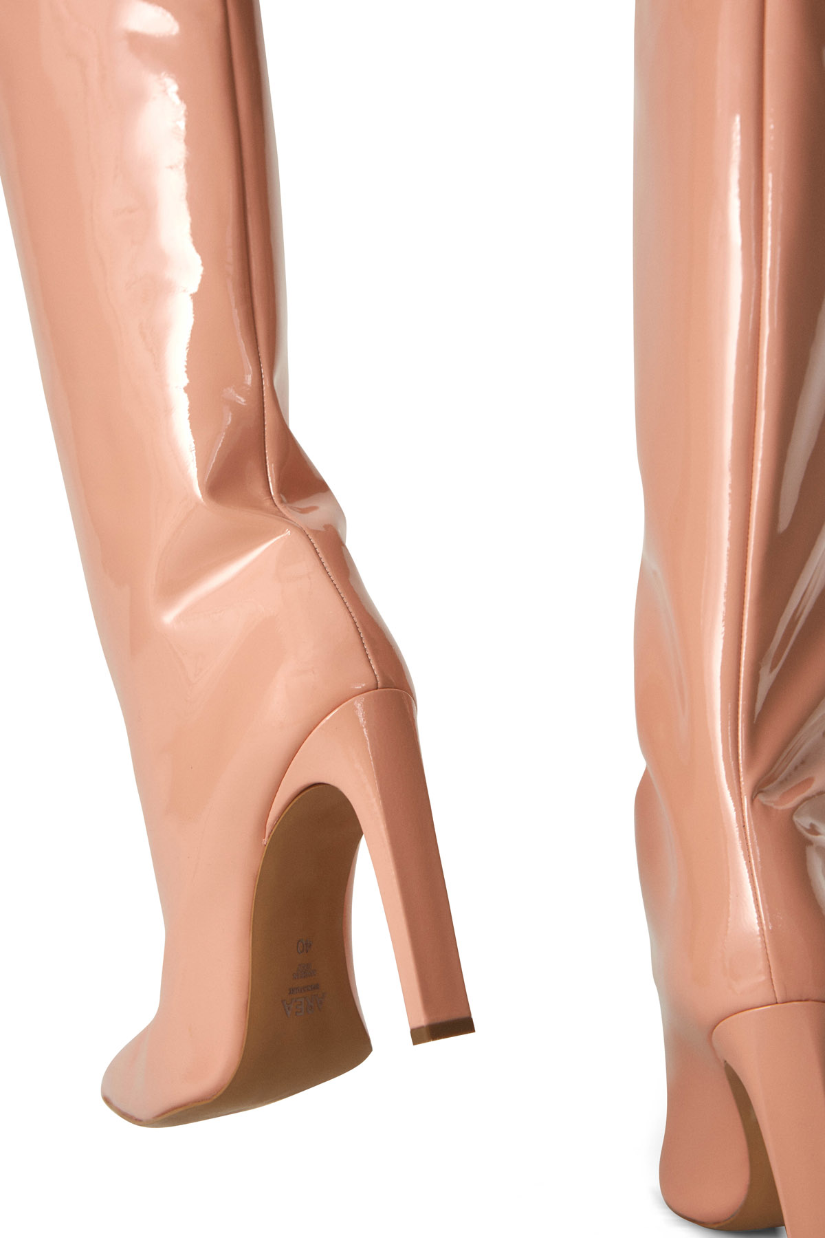 Featuring a stiletto heel and pointed toe, these knee-high boots are crafted in a glossy blush patent leather.