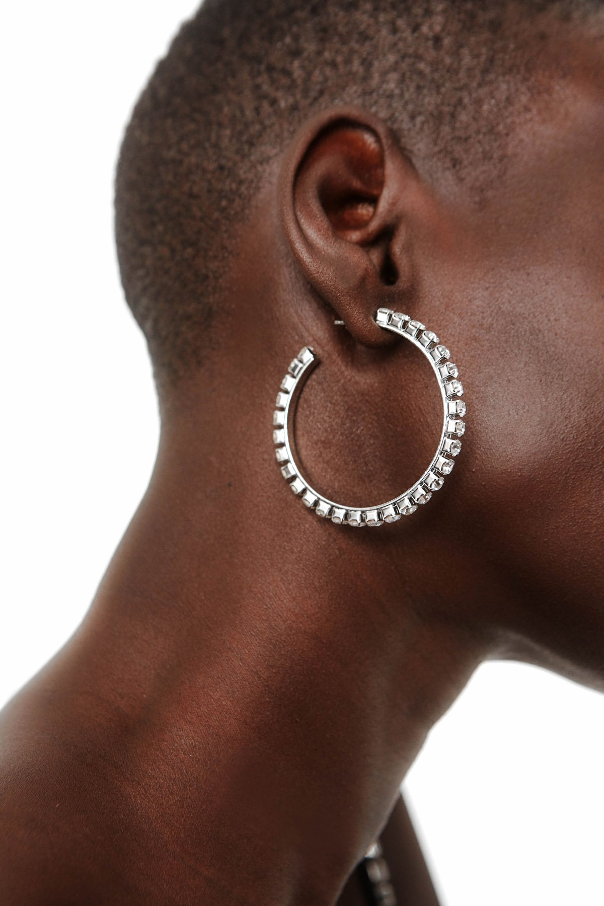2-inch hoop earrings crafted of polished silvertone brass set with shimmering white Preciosa crystals. Imported.