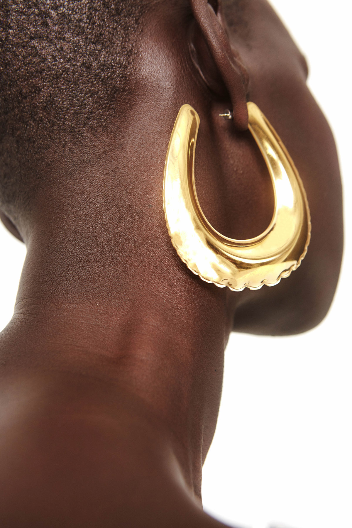 3-inch oversized belt buckle earrings crafted in brass metal in goldtone finishing. Crafted to mimic the silhouette and look of an inflated balloon. Post-back fastening. Imported.