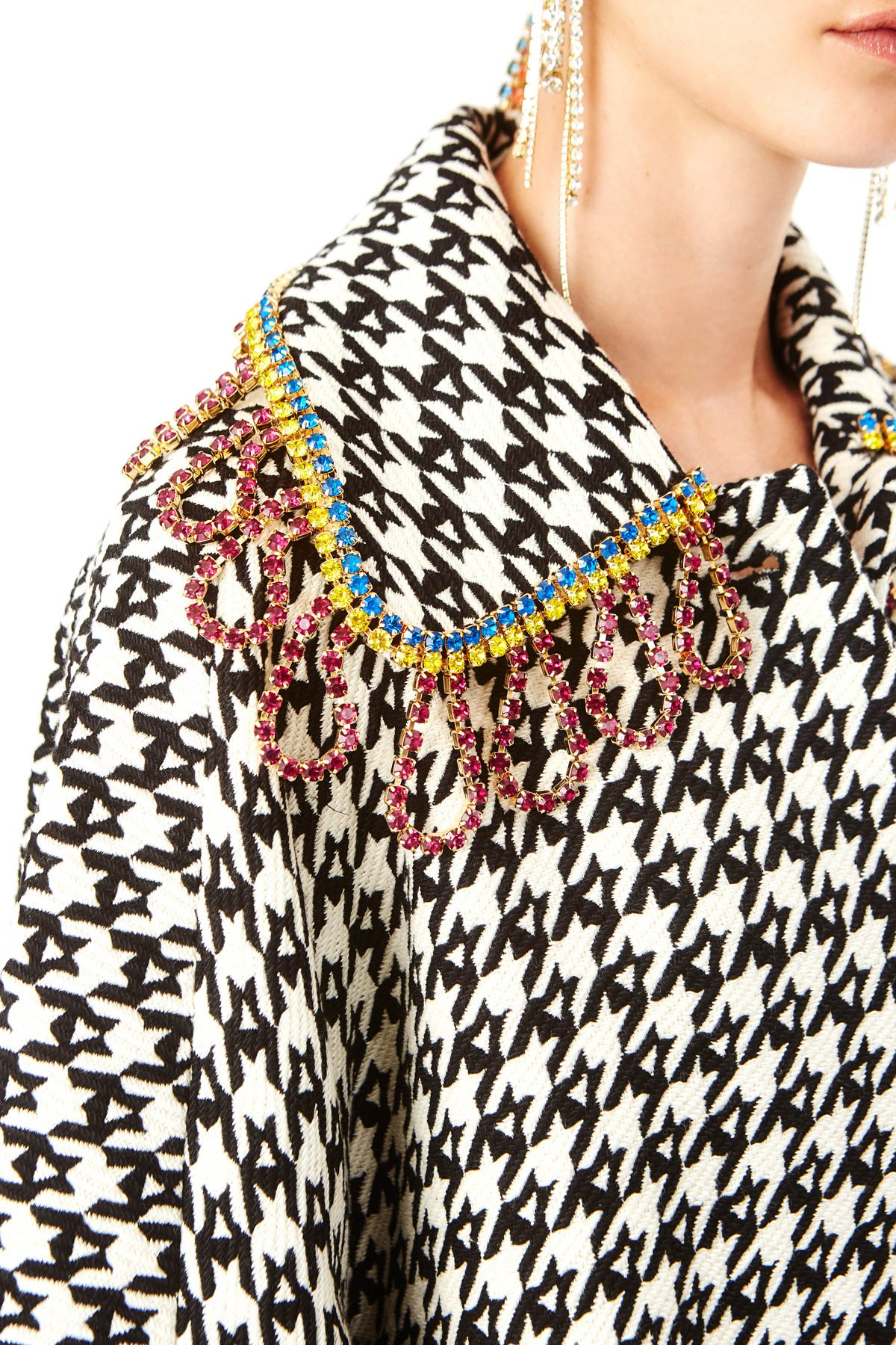 Cocoon-shaped jacket featuring multi-colored crystal loop fringe on collar. Available in Black/Ecru Houndstooth.