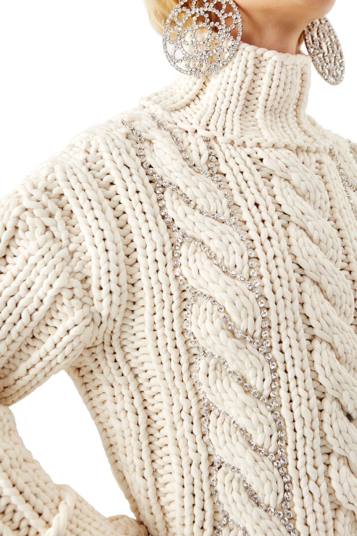 Knitted sweater in a cropped fit. Features clear crystal embellishment. Available in White.