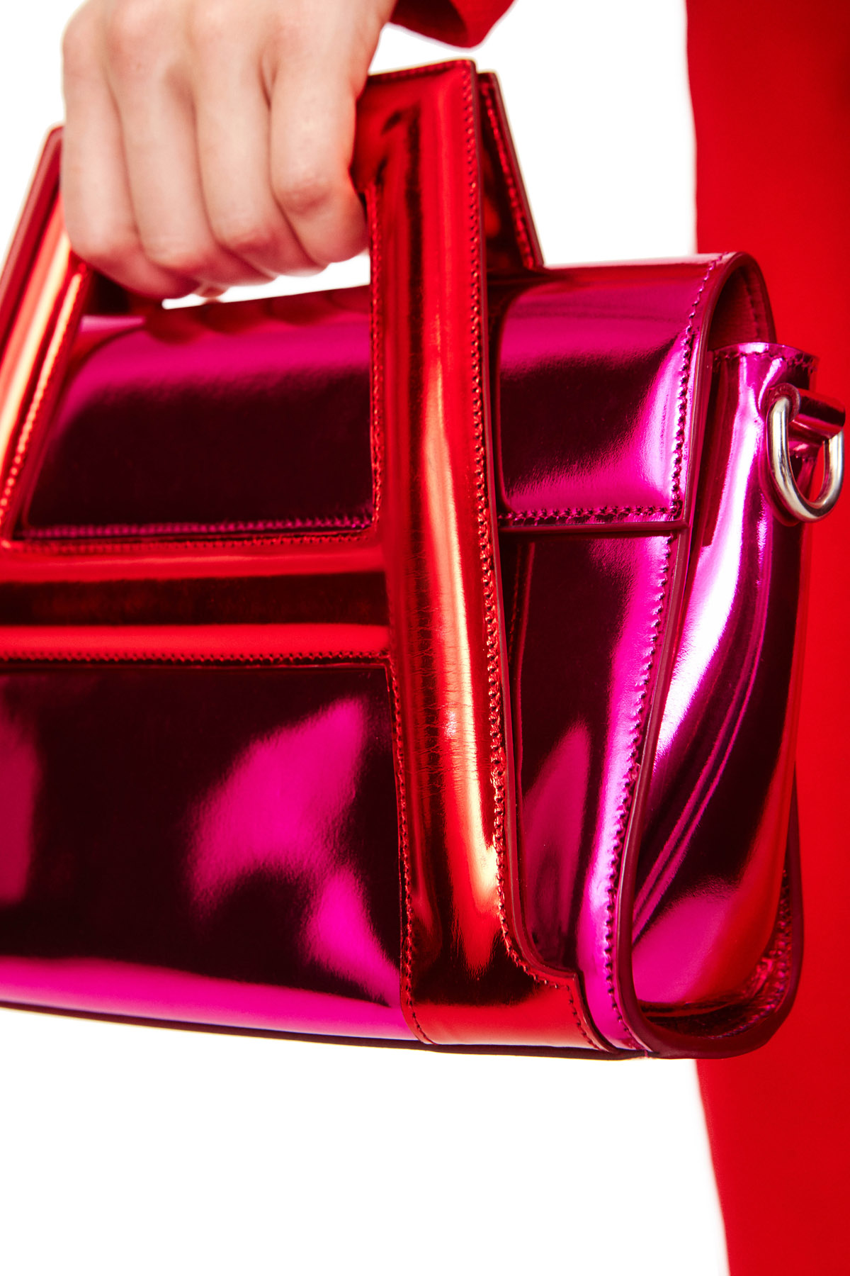 """A"" Bag in laminated leather. Removable shoulder strap. Palladium hardware. Available in Fuschia/Red"