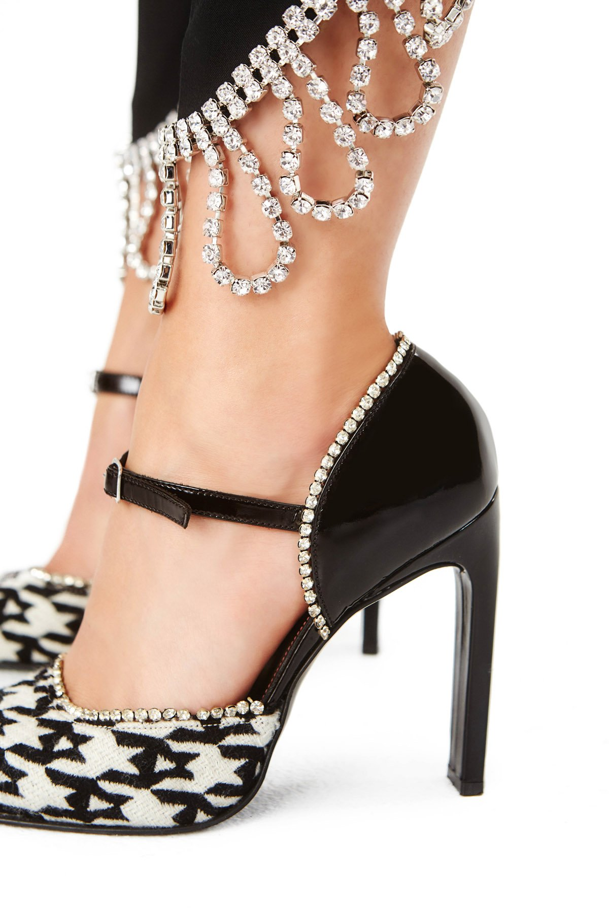 Pointed toe pumps. Mary Jane-style strap. 90MM Block Heel. Buckle closure. Available in Black/Ecru Houndstooth.