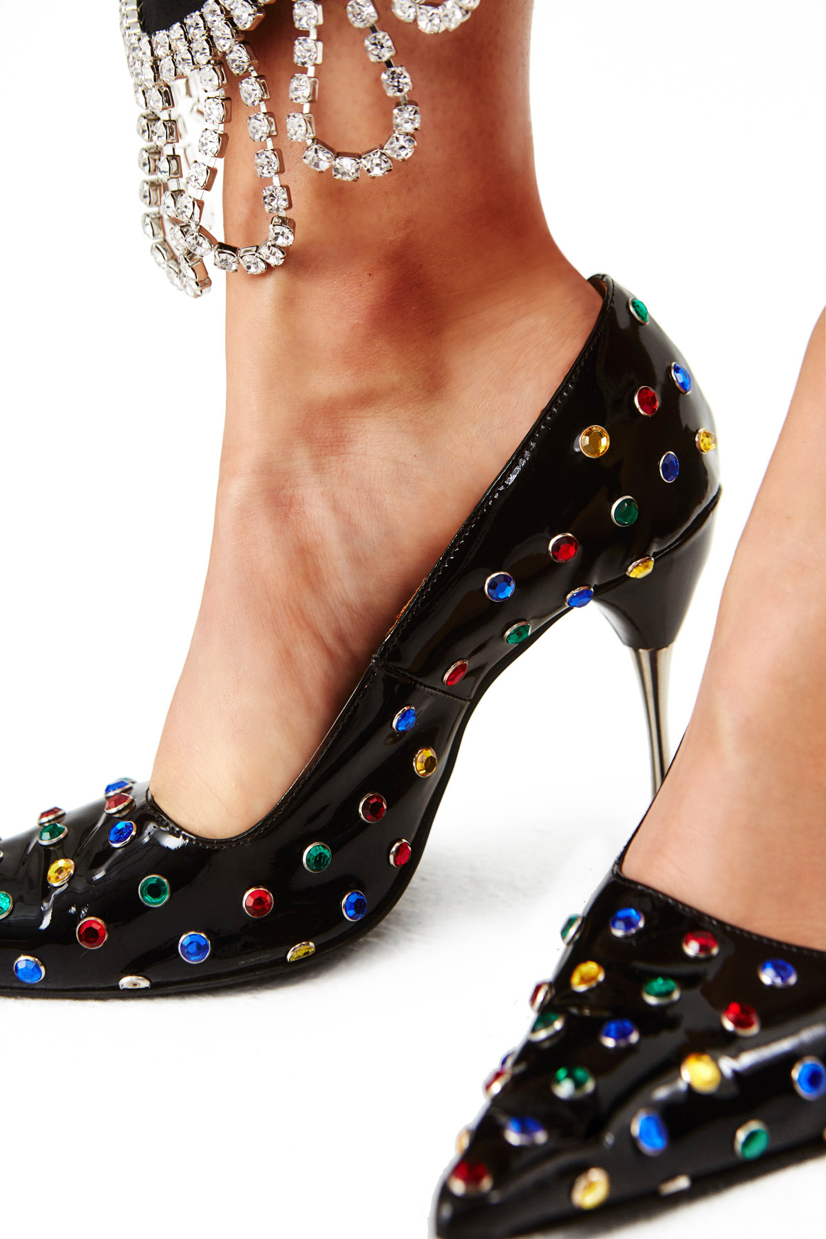 Black patent leather pump embossed with multi-color crystal studs. 90MM heel. Silver heel hardware.
