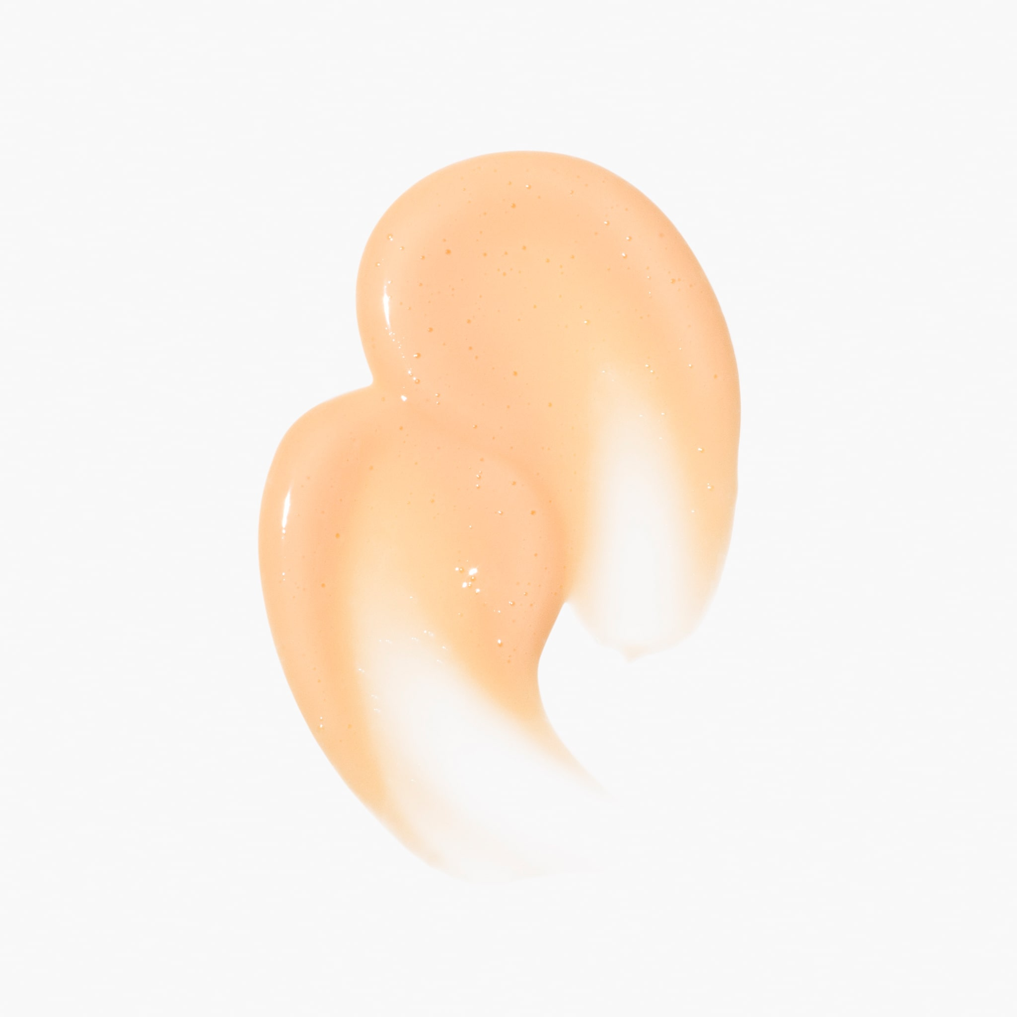Close-up of peach-colored, creamy Naked Papaya Face Cleanser | KInship