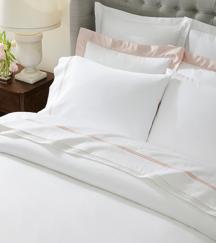 Bed made with Eyelet Sheet & Duvet Set in White