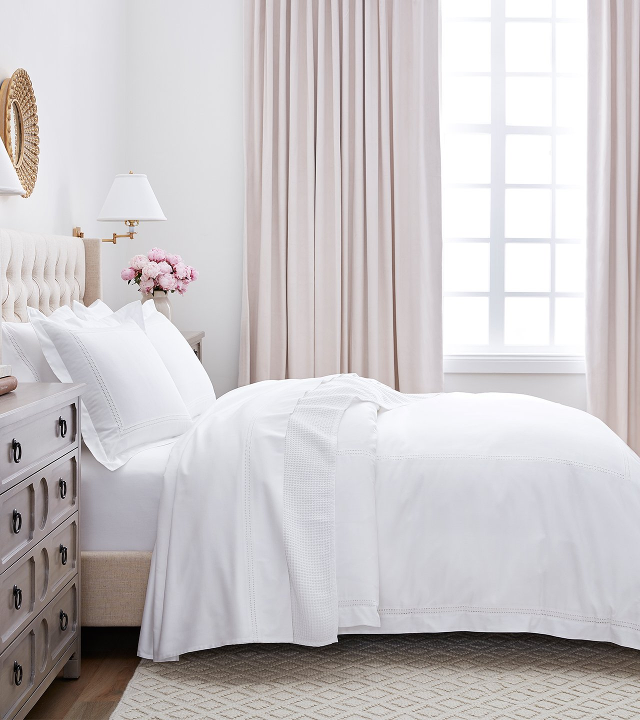 Profile Shot of bed made with Eyelet Duvet & Sheet Set in White