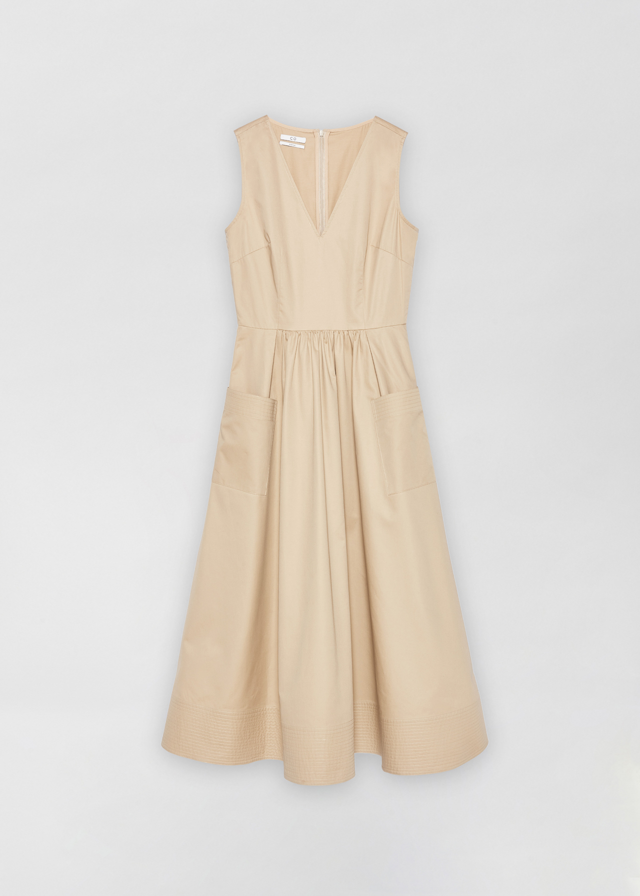 Sleeveless Trapunto Hem Dress - White in Taupe by Co Collections