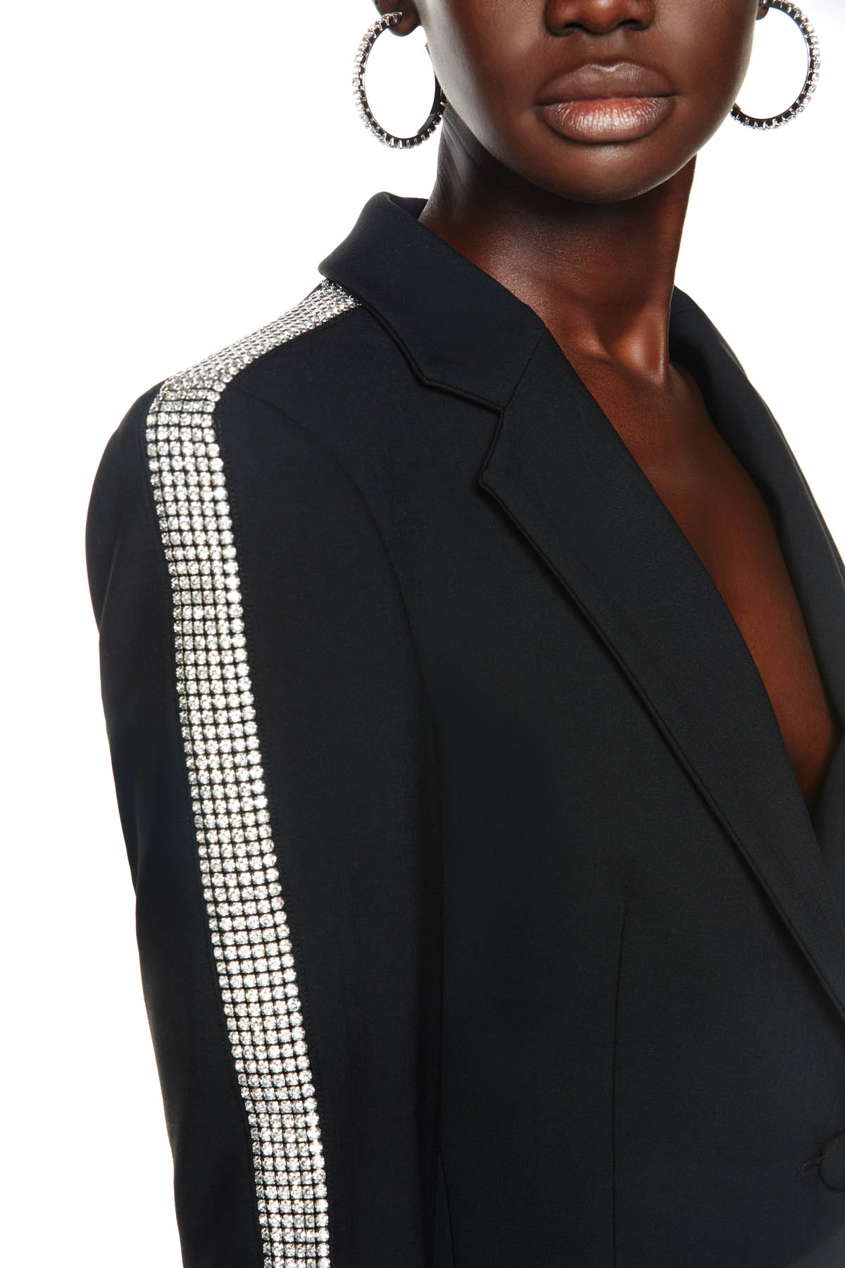 Tailored long sleeve blazer with crystal stripe embellishment. Available in black.