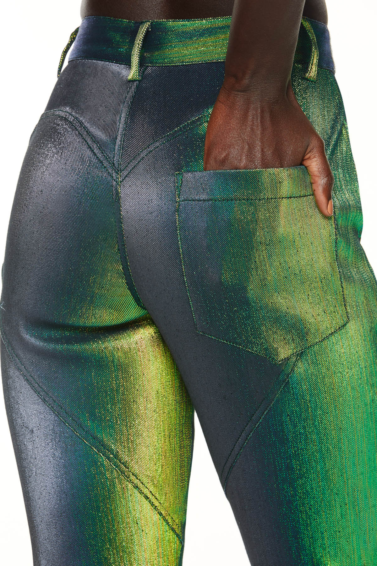 Stretch lamé pant features heart-shaped seaming on back. Detailed with AREA logo hardware button closure. Available in beetle green.