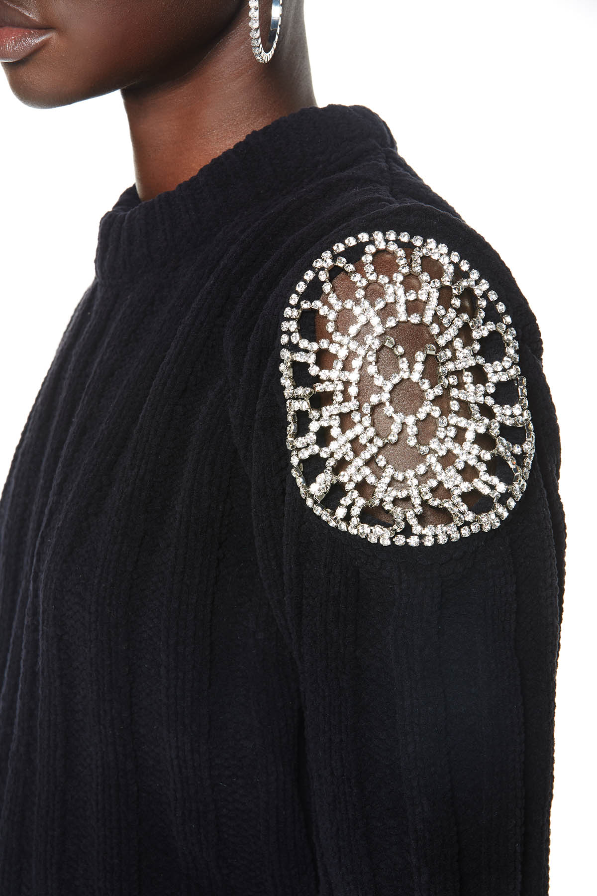 Cropped knitted sweater with clear crystal doily inserts on shoulders. Available in black.