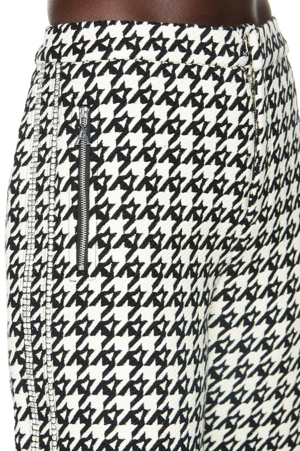 "Wide legs pants with polished silver-tone hardware and crystal two-stripe embellishment. Side zip pockets with classic ""A"" logo pull. Available in black/ecru houndstooth."