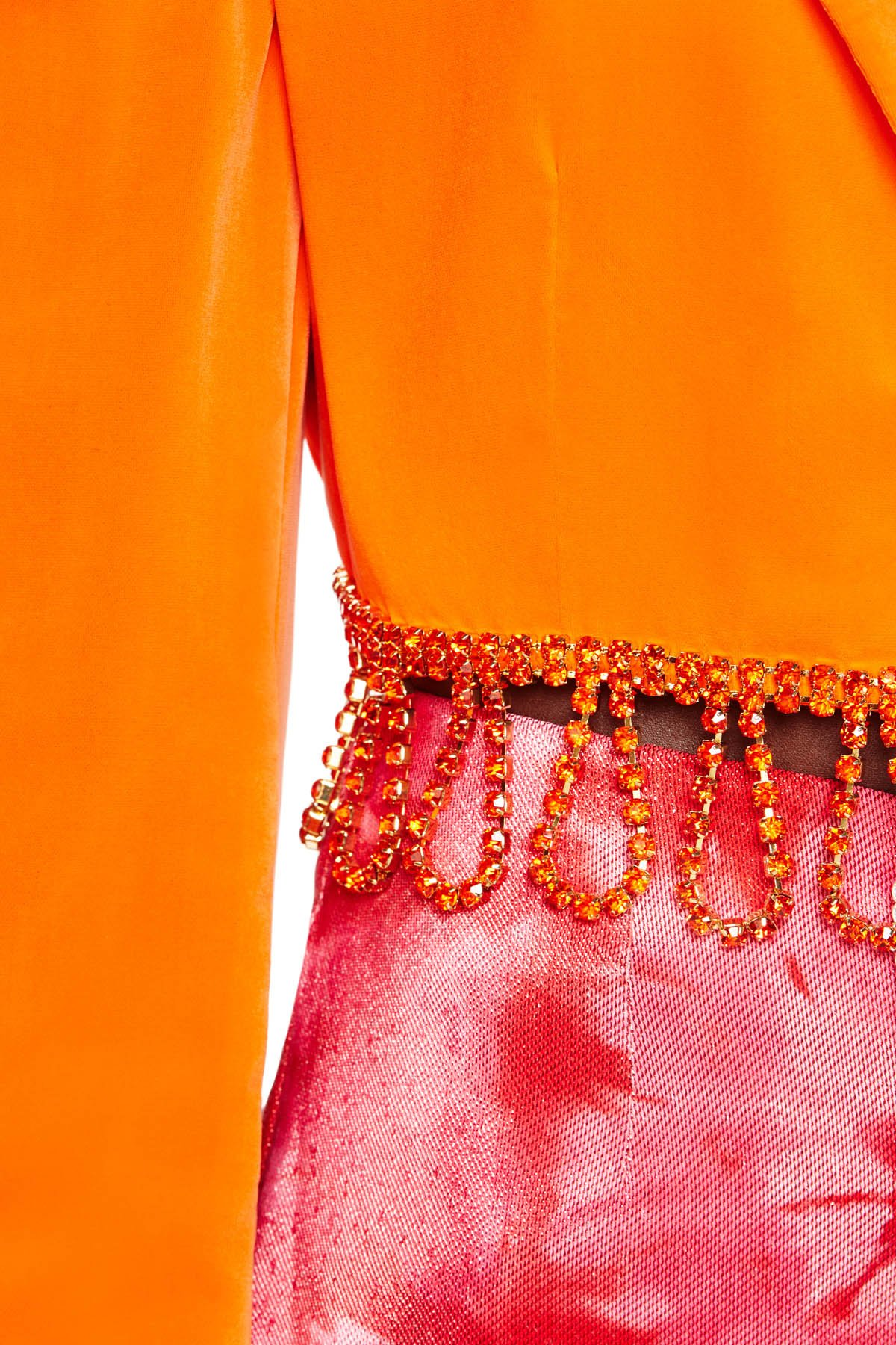 Cropped bolero-inspired jacket with orange crystal loop fringe at hem. Available in fluo orange.