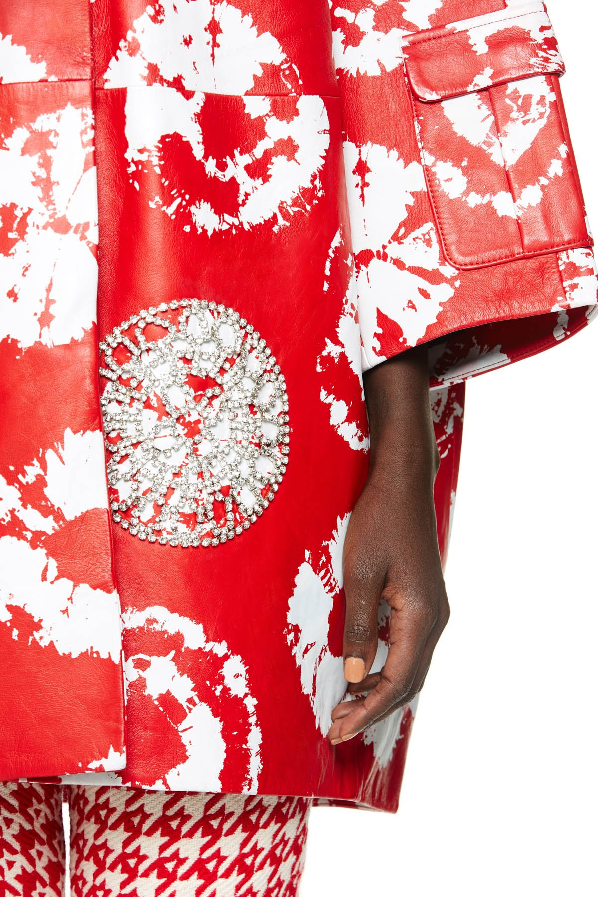 Cocoon-shaped jacket featuring clear crystal crochet detail on a shibori tie dye print. Available in red/white.