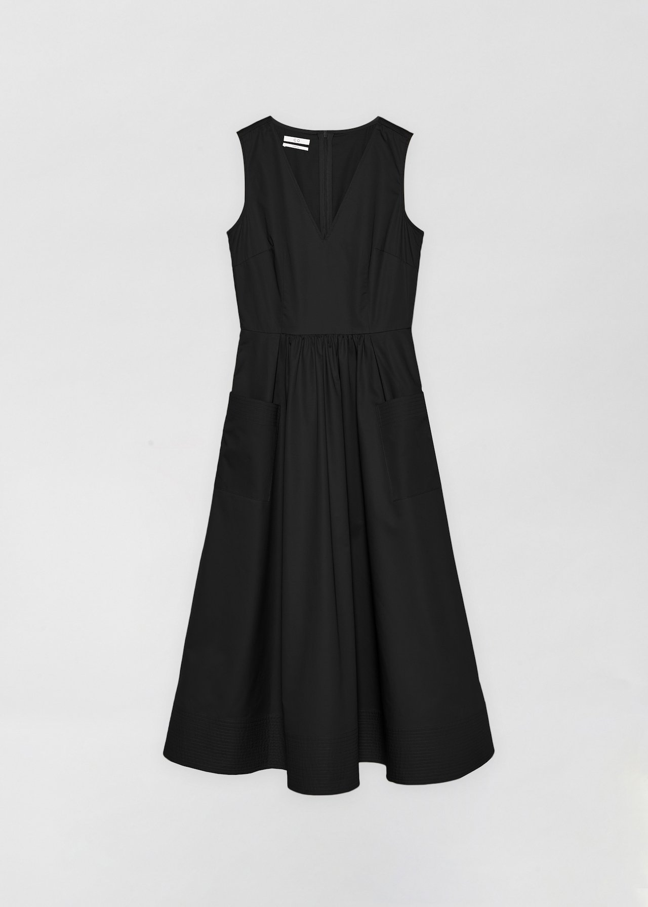 Sleeveless Trapunto Hem Dress - White in Black by Co Collections