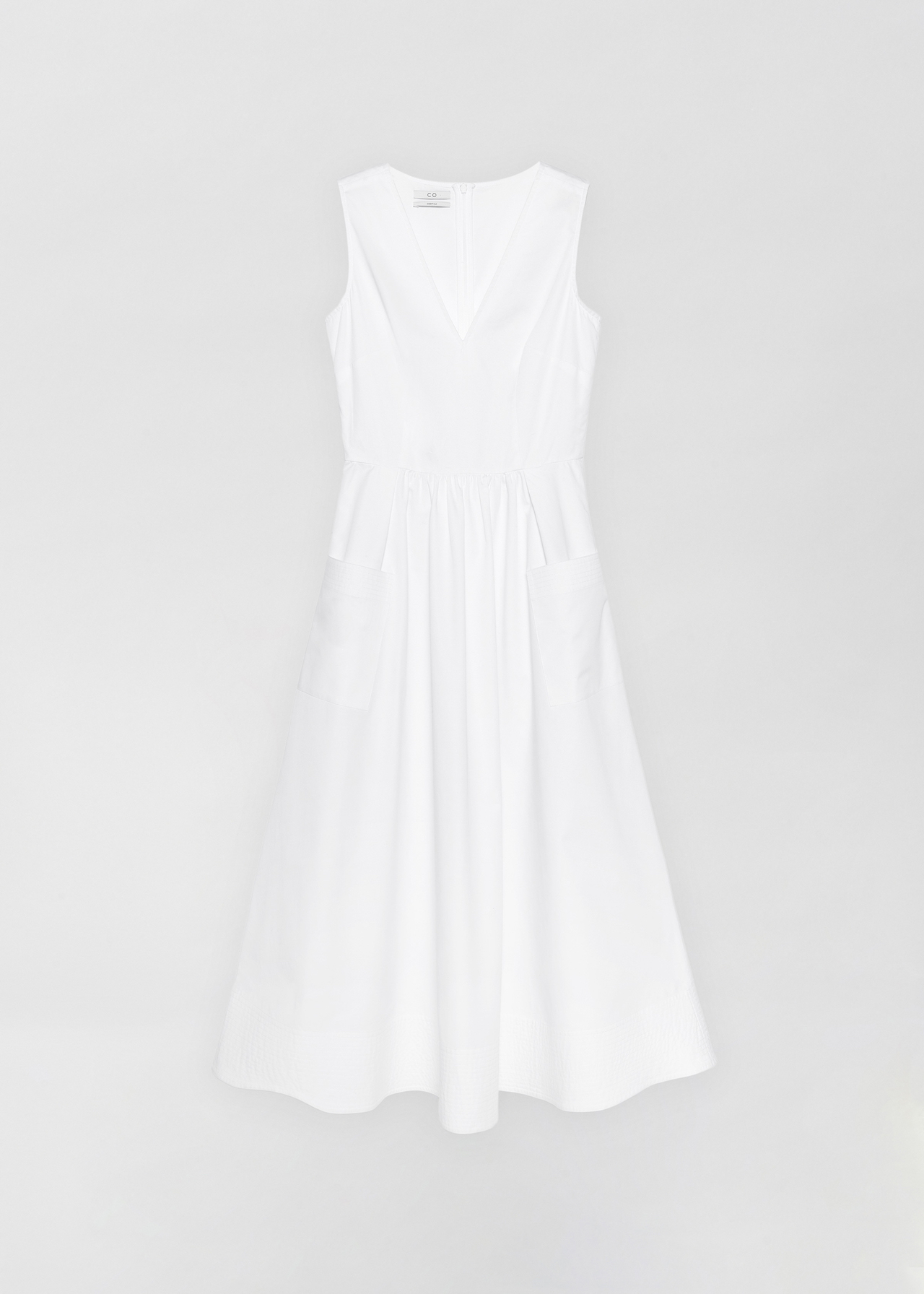 Sleeveless Trapunto Hem Dress - Navy in White by Co Collections